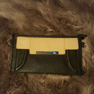 Nude and black clutch