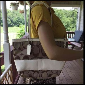 Gently used coach tote in khaki color.