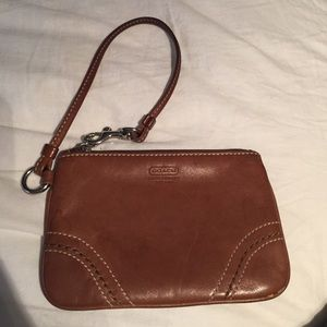 Brown, leather Coach Wristlet