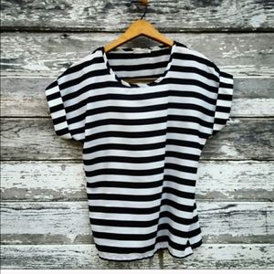 Black and white striped top with vertical stripes