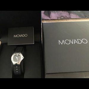 Ladies Movado Swiss made with 18 diamonds watch.