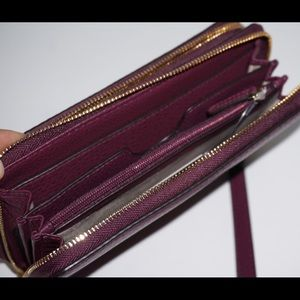 e7b9da75d532 Michael Kors Bags - Michael Kors plum Adele wallet