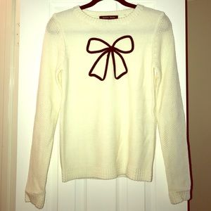 Cream Sweater with Black Bow