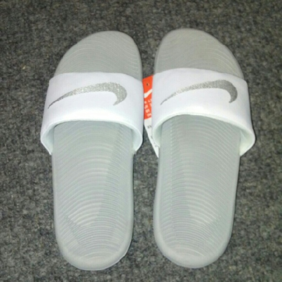 0067457821b9 Nike Womens kawa slides white metallic silver