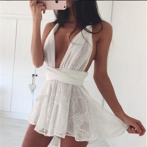 LF Dresses & Skirts - ❤️SALE❤️ white lace plunge cross open back romper