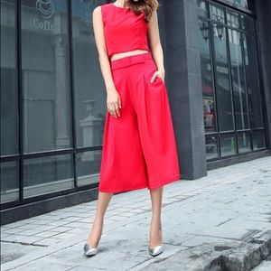 Red Two piece crop top and wide legs pant set.