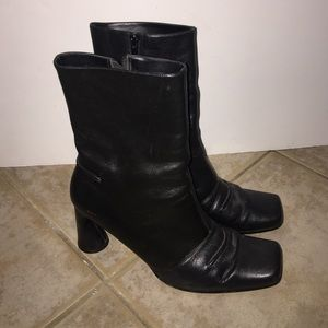 Newport News black leather heeled boots