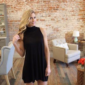 Dresses & Skirts - Black sleeveless turtleneck tunic/mini dress