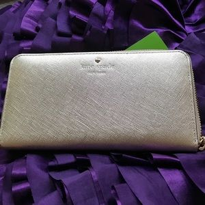 kate spade Handbags - Kate Spade gold wallet, so many pockets, dividers!