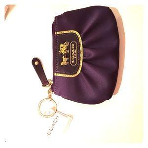 Coach plum coin purse