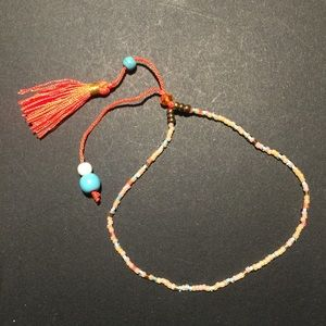 Jewelry - Orange and green bohemian bracelet with tassels