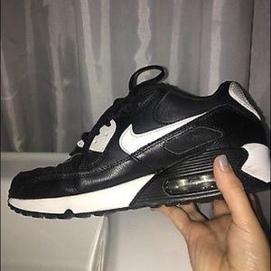 Size 7, women's Black and White Nike Air Max