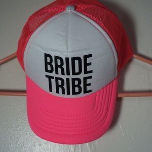 "Hot pink ""Bride Tribe"" trucker hat."