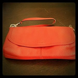 Coach orange clutch bag wristlet
