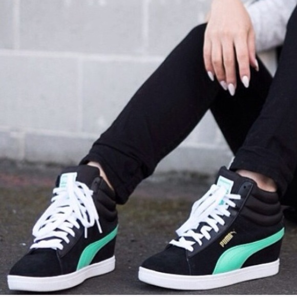 a473e16a489a Puma Women s Classic Wedge Sneakers. M 5872c9f12ba50ac342022d8d
