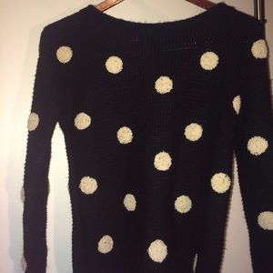 Black and white knitted polka dot sweater