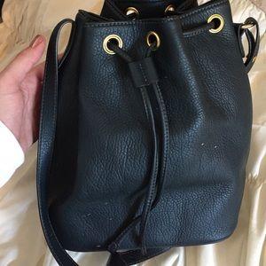 Dark emerald bucket bag