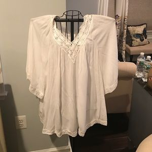 White tunic with lace neckline