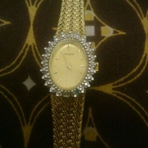 pulsar Jewelry - gold pulsar watch with diamonds around the face.