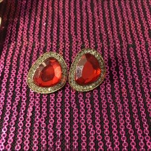 Post earrings with red stone