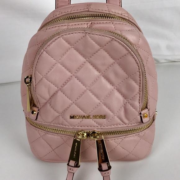 787770bb6494 New Michael Kors Rhea Mini Messenger Backpack. M_5875c7067f0a058a8e0382ed