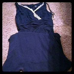 Navy dress with cream trim sleeve less