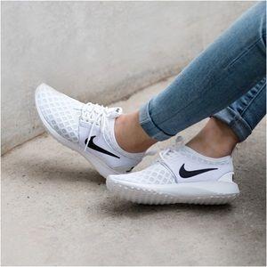Nike White + Black Juvenate Sneakers