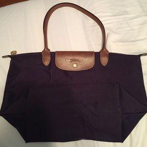 Longchamp Handbags - Authentic Long handled large longchamp le pliage
