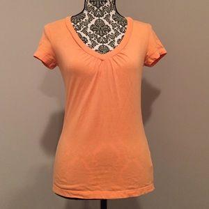 New York & Company Tops - Orange v-neck tee. XS