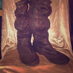 Brown faux suede boots.