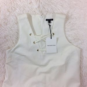 who what wear Dresses & Skirts - WHOWHATWEAR white sleeveless front lace-up dress