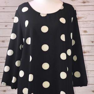 Black and white polkadot blouse from StitchFix. L
