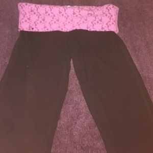 Black yoga pants with pink lace around the waist