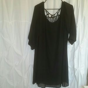 Plus-size black dress with back cutouts