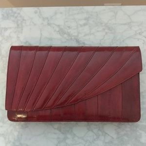 Handbags - Asymetrical Eelskin clutch with suede interior