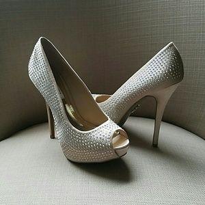 5 inch Jennifer Lopez peep toe pumps