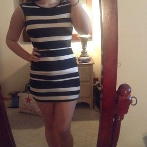 Black and white body con dress with caged back