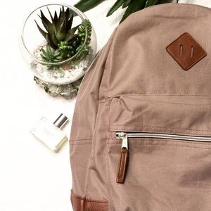 BOUTIQUE Handbags - $65 CANVAS AND LEATHER BACKPACK