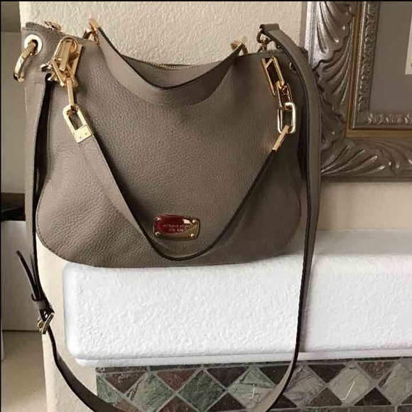 f82c0dd38e HOLD  Authentic 100% MK leather bag color taupe