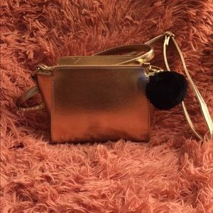 Rose Gold Cross body bag with Pom Pom