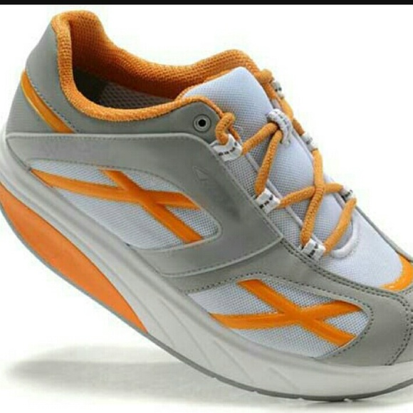 116698c819d9 MBT M Walk Orange Fitness Shoe. M 587d32aac2845613740eb08e