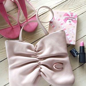 Carven Handbags - 💟RARE🛍Carven Paris Leather Bow Clutch