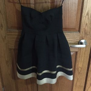 Chico's Dresses & Skirts - Black dress with a gold bottom