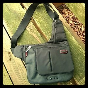 Tumi Handbags - TUMI Tech NWOT crossbody bag 5135D