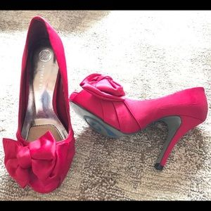 Red satin pumps