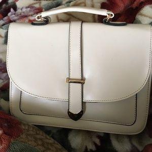 Tan handbag with four inside pockets