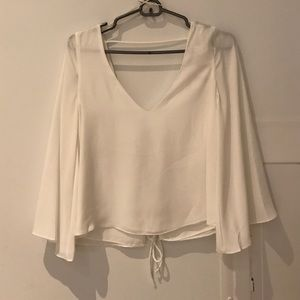 Brand new Zara top with tie back and bell sleeves