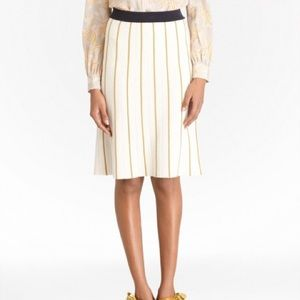 A lined sweater skirt. Banded waist. Knee length.