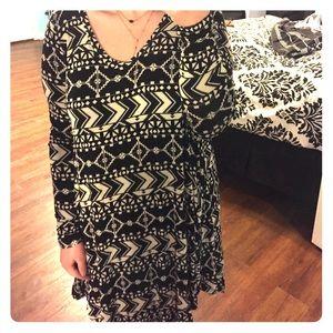 Black geometric printed long sleeve dress.