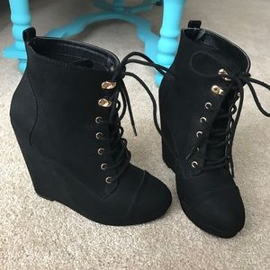 Lace up black wedge booties